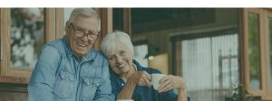 Home Page Happy Elderly Coupole Smiling at Camera