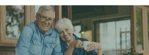 Happy Elderly Couple Smiling at Camera
